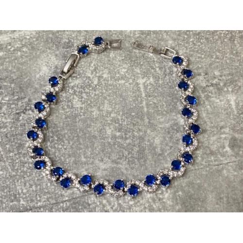 57 - Silver blue and white CZ set line bracelet, 12.6g