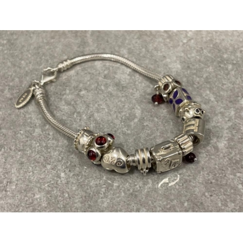 Ladies silver charm bracelet. 11 assorted silver charms complete with lobster catch