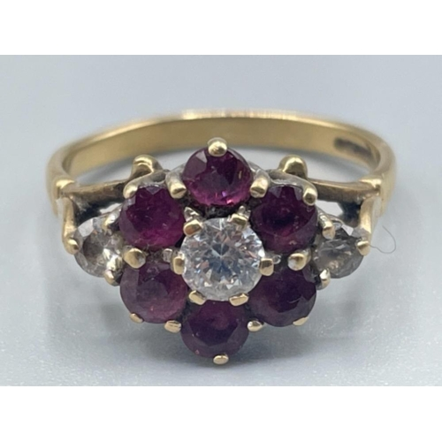 Ladies 9ct gold red stone and CZ ring. 3.15g size N1/2