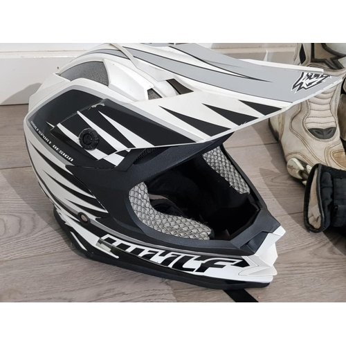 16 - Wolf motorbike helmet together with euro size 41 boots, 52 pants etc