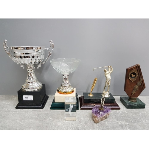 Four golfing trophies of various designs and two blank trophies.