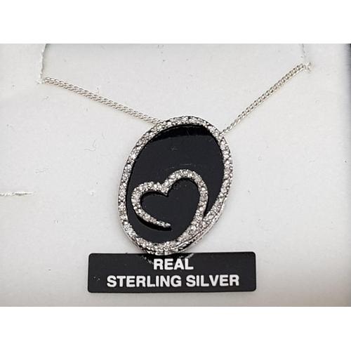 22 - Silver heart design CZ set pendant and chain, 3.5g gross