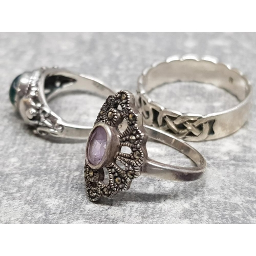 25 - 3 silver rings includes celtic band, onyx and marcasite, combined gross weight 7.9g gross