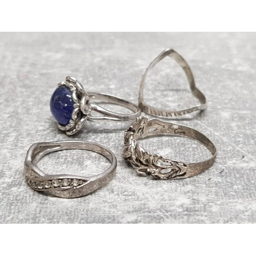 26 - 4 silver rings including wishbone, CZ band and blue stone etc, 10.1g gross