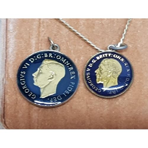 28 - 2 enamel decorated coin pendants, one with chain