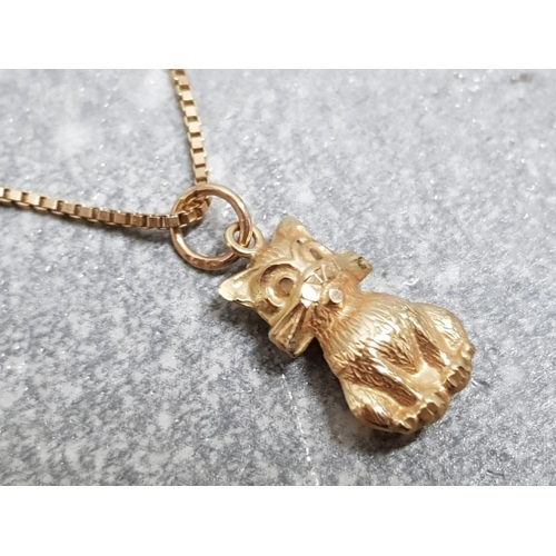 34 - 9ct yellow gold box link bracelet and 9ct gold cat pendant, 1.6g