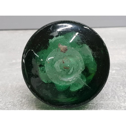 49 - Victorian green glass dump paperweight with 2 internal flowers