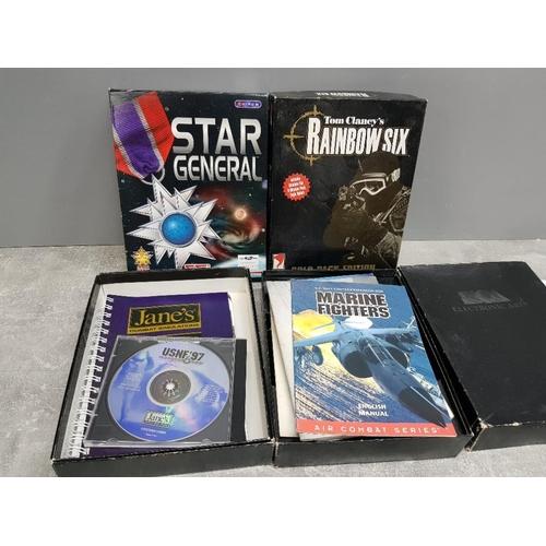 52 - 4 vintage PC games includes titles Tom Clancys Rainbow Six, Marine Fighters, Jane's combat simulator...