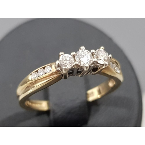Ladies 9ct yellow gold diamond ring with 3 round brilliant cut diamonds in the centre and 3 more on each shoulder, apx. 25ct, 2.1g gross, size L