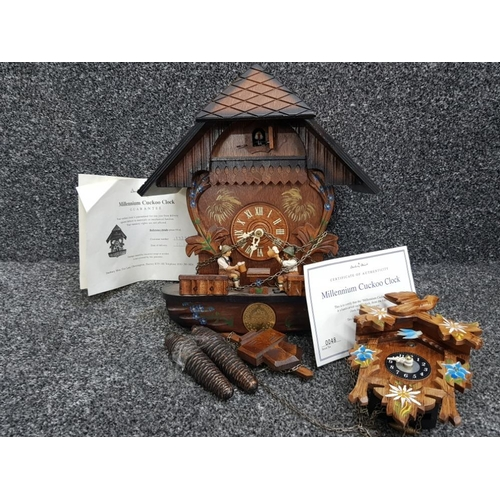 German Danbury Mint Millennium 2000 hand carved wooden cuckoo clock with pendulum, weights and certificate of authenticity plus 1 other wooden clock