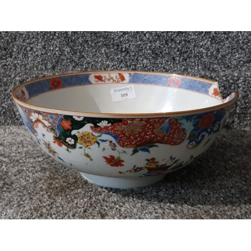 A 19th century Chinese bowl with enamel decoration 26cm diameter.