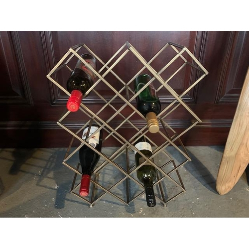 162 - NEW BOXED EXCEPTIONAL DESIGNER WINE RACK IN A BRASS FINISH (APPROX 60CM)