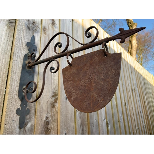 124 - IRON ORNATE WALL HANGING SIGN