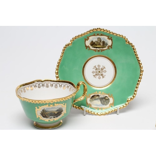 30 - A FLIGHT, BARR & BARR PORCELAIN TEA CUP AND SAUCER painted with named vignette panels comprising