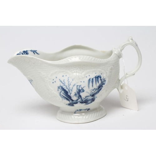 40 - A FIRST PERIOD WORCESTER PORCELAIN SAUCEBOAT, c.1765, of lobed oval form with scroll moulded panels ...