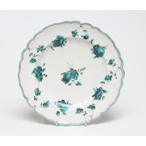 41 - A CHELSEA PORCELAIN PLATE, c.1755, of fluted circular form, painted en camaieu green in the atelier ...