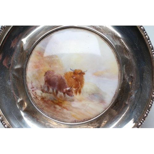 48 - A ROYAL WORCESTER CHINA ROUNDEL, 1912, the slightly domed roundel painted by Stinton in polychrome e...