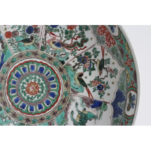 5 - A CHINESE PORCELAIN SAUCER DISH of plain circular form, painted in famille verte enamels with minare...