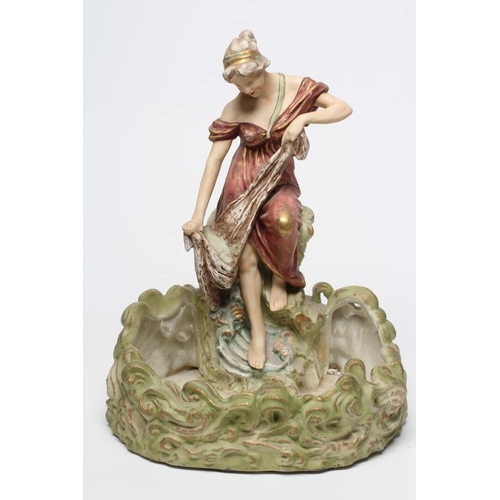 56 - A LARGE ROYAL DUX STYLE BISQUE PORCELAIN FIGURAL CENTRE BOWL, early 20th century, modelled as a youn...