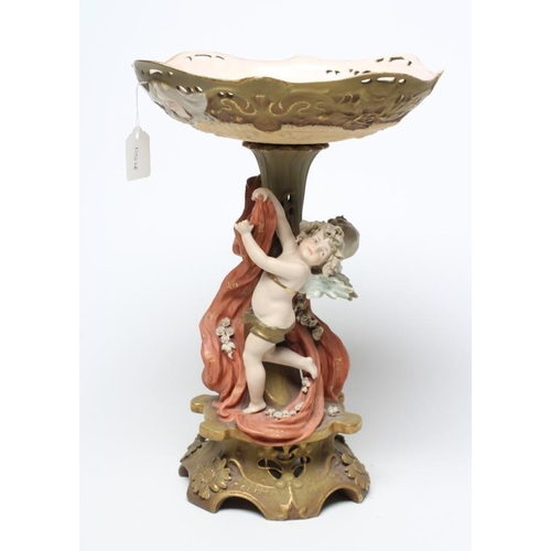 57 - A TURN OF VIENNA BISQUE PORCELAIN FIGURAL TABLE CENTREPIECE, early 20th century, modelled as two put...