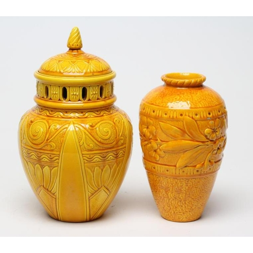 59 - A BURMANTOFTS POT POURRI JAR AND COVER of flared rounded cylindrical form with arcade pierced should...