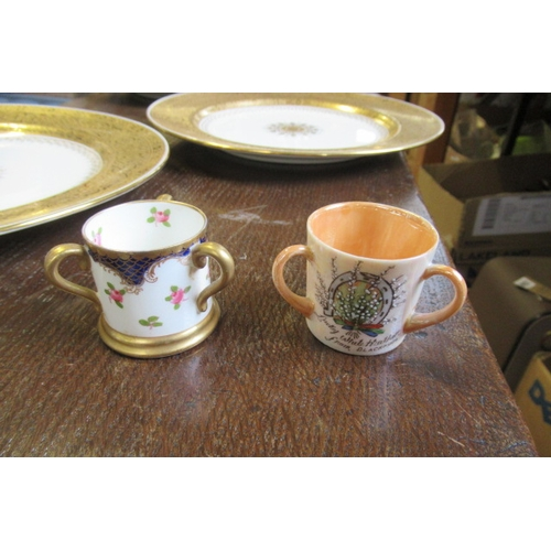 268 - THREE MINTON PLATES AND TWO MINIATURE LOVING CUPS...