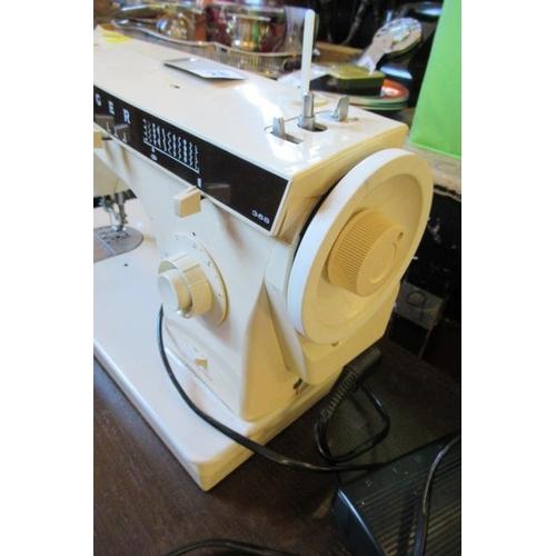 28 - ELECTRIC SINGER SEWING MACHINE...