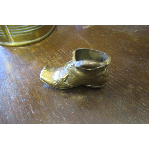 47 - BRASS WATERING CAN AND SMALL BRASS BOOT...