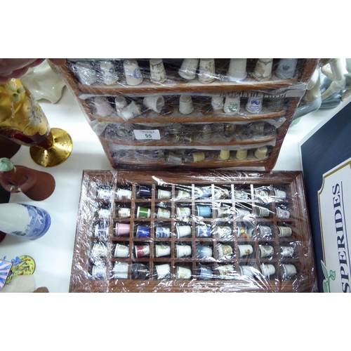 55 - Two collections of thimbles...