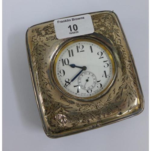 10 - Silver watch case / frame, Birmingham 1945 containing a Goliath pocket watch (2)...