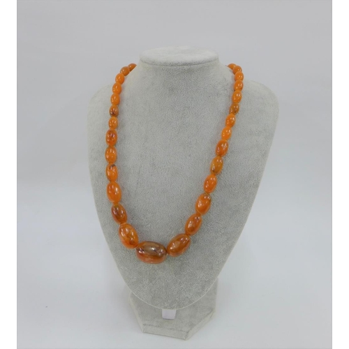 2 - Strand of faux amber beads...