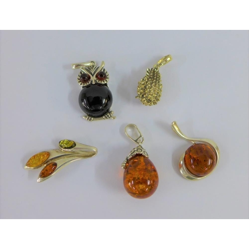 20 - Five various silver and amber pendants (5)...