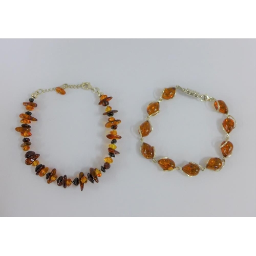 27 - Two silver and amber bracelets (2)...