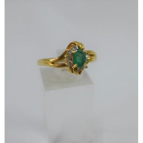 3 - 18 carat gold emerald and diamond dress ring, UK ring size U...