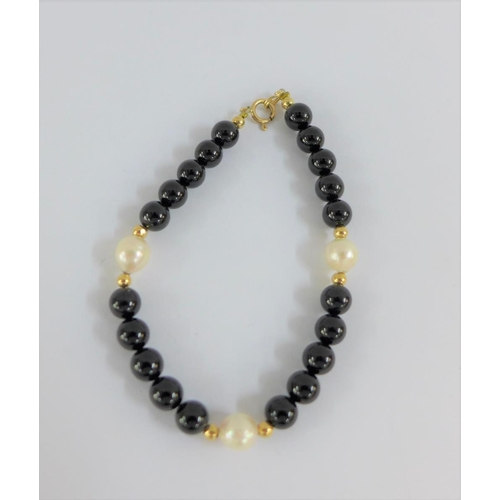 32 - 14 carat gold pearl  and black hardstone bracelet...