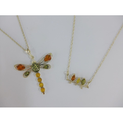 35 - Two silver and amber pendant necklaces (2)...