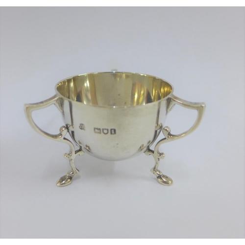 45 - Edwardian miniature silver bowl, with three loop handles and hoof feet, London 1906, 5cm high...
