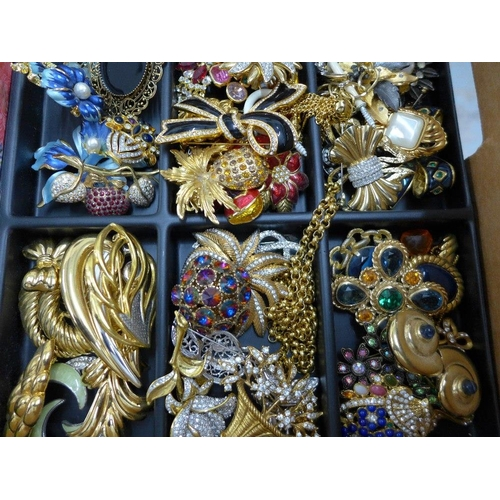 48 - A large quantity of costume jewellery to include necklaces, brooches and clip on earrings, etc conta...