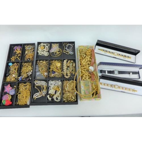 50 - A large quantity of costume jewellery to include wristwatches, necklaces, brooches and clip on earri...