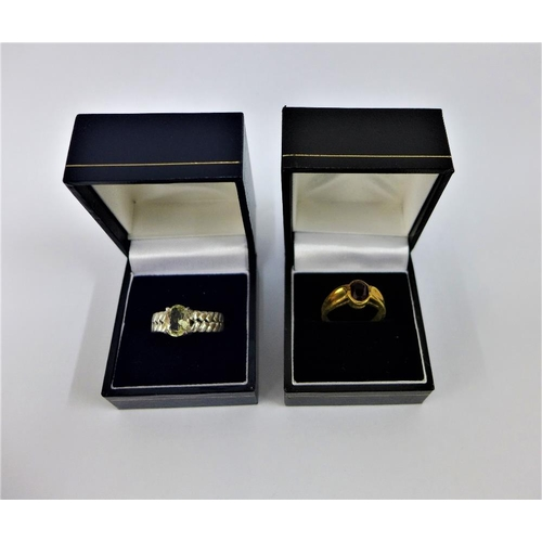 58 - 9 carat gold gemset dress ring together with a silver and yellow beryl set dress ring (2)...