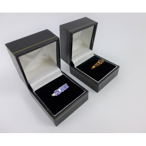 60 - 9 carat white gold tanzanite dress ring together with a 9 carat gold spinel dress ring (2)...
