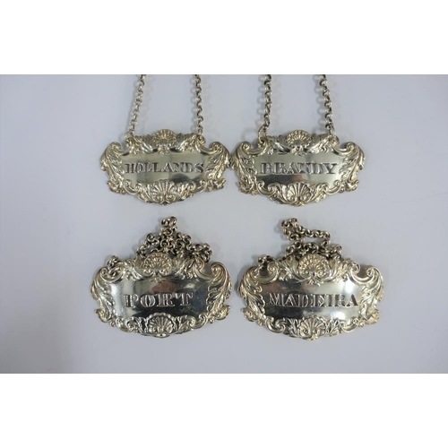 22 - A set of seven 19th century Scottish silver decanter labels, James Howden & Co and George Paton, com...