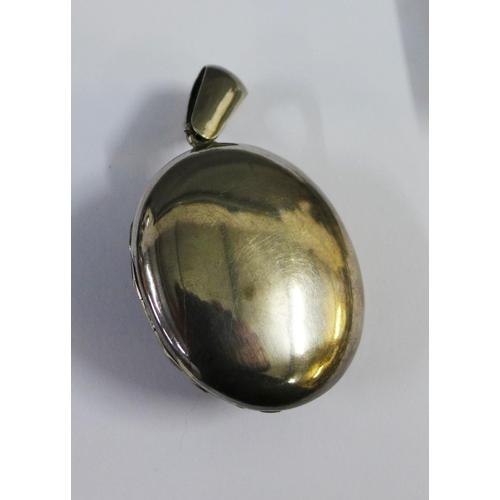 28 - An Eastern white metal locket with Thai style figures and an Eastern white metal box, the cover with...