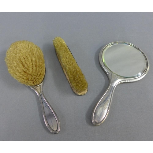 32 - George V silver backed brush set, Birmingham 1918, comprising mirror, clothes brush and hairbrush (3...