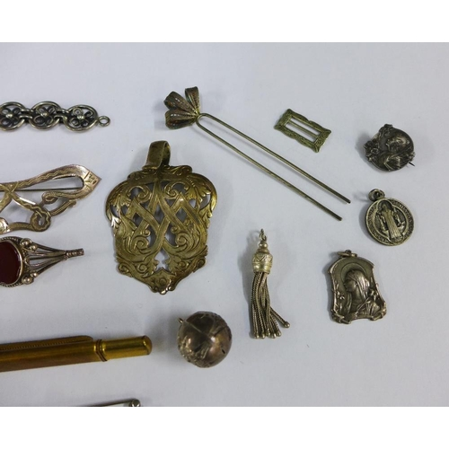 55 - Early 20th century silver and white metal items to include a buckle, hair slide, brooches, bracelet,...