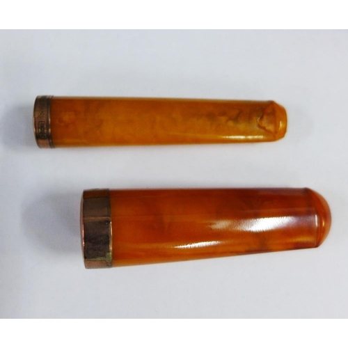 60 - Two 9ct gold mounted amber cheroot's, with cases, (2)...