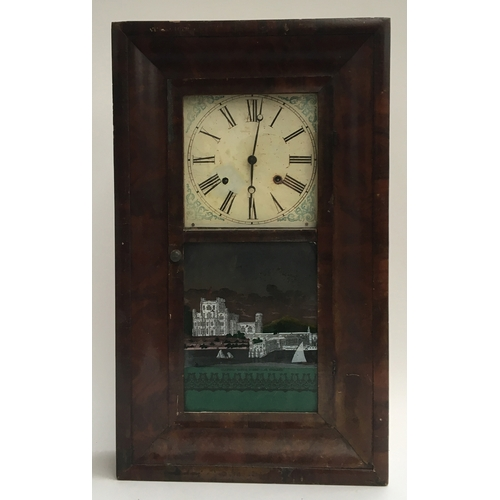 61 - An American ogee wall clock with a painted glass panel of a town...