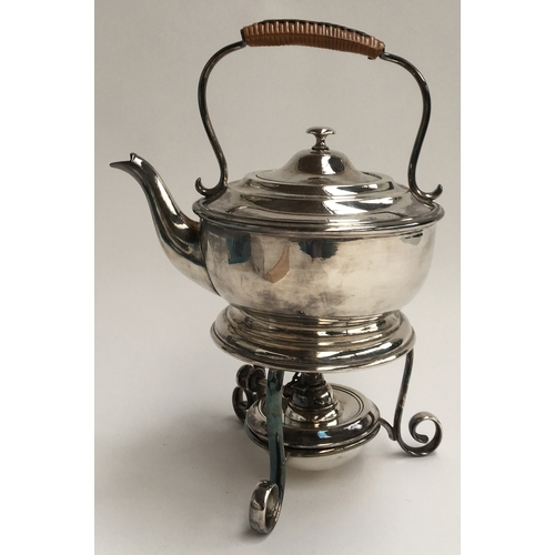 37 - An early 20th century silver plate teapot with wicker handle on stand with burner, made by Thomas Wh...