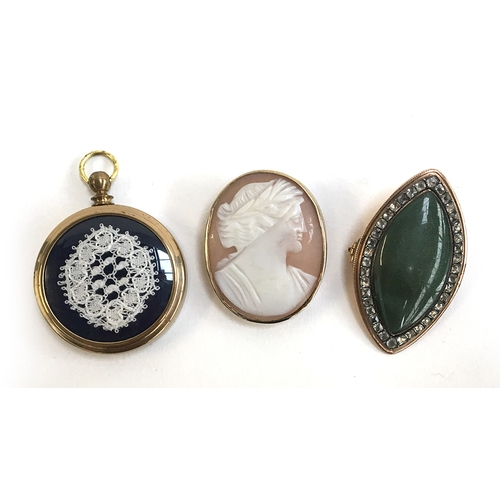 21 - Two brooches, one a cameo, together with a lace pendant...