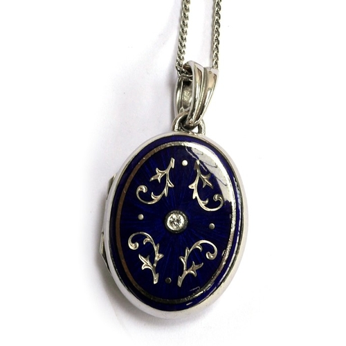 31 - A modern FABERGE 18ct locket (stamped 750) with blue enamel decoration & central diamond set  with c...